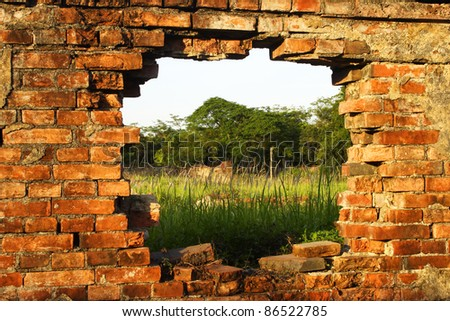 Hole in the wall inside the purple forbidden city in Hue in Vietnam South East Asia - stock photo