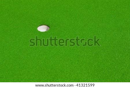 hole on a mini-golf course - stock photo