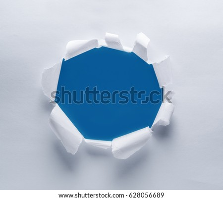 Hole on a paper. Blue background in the hole.