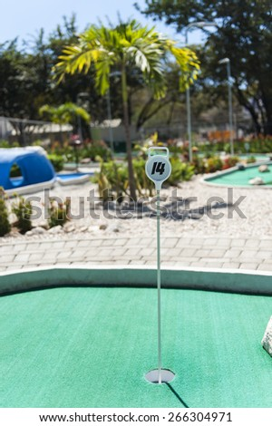 Hole 14 on a tropical outdoor mini golf course - stock photo