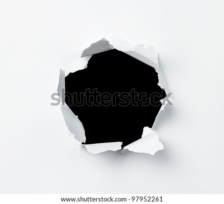 Hole punched in the paper sheet - stock photo