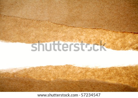 Hole ripped in brown paper on white background - stock photo