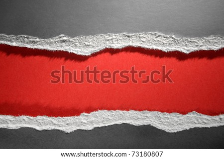 Hole ripped in grey paper on red background - stock photo