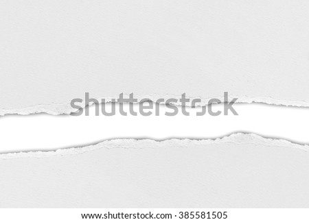 Hole ripped in paper on white background - stock photo