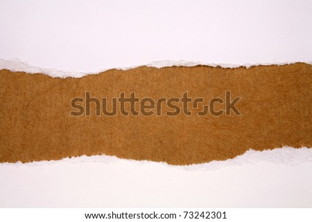 Hole ripped in sheets of paper - stock photo