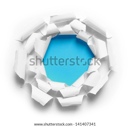 Hole ripped in three white paper on blue background