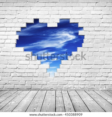 hole shape heart inside brick wall - stock photo