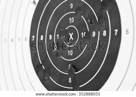 Holes in a shooting practice target. Target With Hits. - stock photo