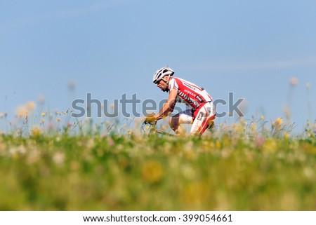 HOLESOV, CZECH REPUBLIC - JULY 4, 2015. Biker rides his bike in the Drasal bike marathon, Czech republic. - stock photo