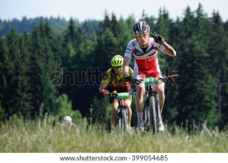 HOLESOV, CZECH REPUBLIC - JULY 4, 2015. Bikers ride their bikes in the Drasal bike marathon, Czech republic. - stock photo