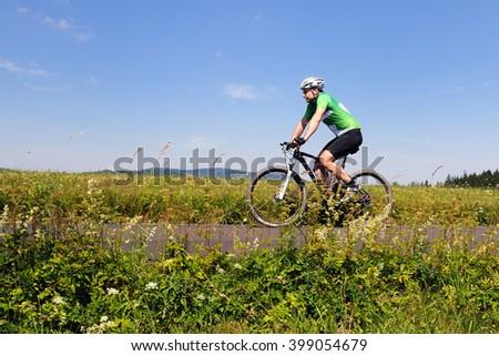HOLESOV, CZECH REPUBLIC - JULY 4, 2015. Bikers rides his bike in the Drasal bike marathon, Czech republic. - stock photo