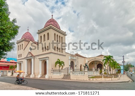 HOLGUIN, CUBA - MAY 1: Cathedral San Isidoro exterior at Peralta park shown on 1 May 2008 in Holguin, Cuba - stock photo
