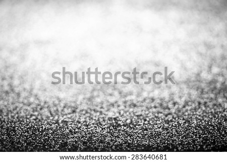 Holiday abstract glitter background with blinking lights and silver defocused texture. White Glitter festive bokeh  - stock photo