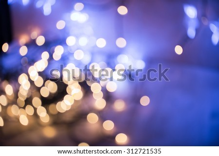 Holiday abstract glowing blurred background. Bokeh. Defocused blinking shaped lights. New Year Abstract Background. Holiday backdrop - stock photo