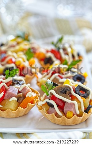 Holiday Appetizers with ham, mushroom, pepper, olive crab and potato