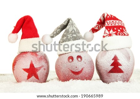 Holiday apples with frosted drawings in snow isolated on white - stock photo