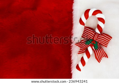 Holiday Background, A plush red stocking with a Candy Cane with copy-space - stock photo
