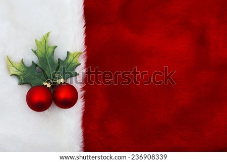 Holiday Background, A plush red stocking with a Mistletoe Ornament with copy-space - stock photo
