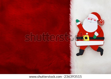 Holiday Background, A plush red stocking with a Santa Claus with copy-space - stock photo