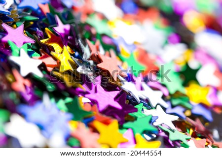 Holiday background;colorful small confetti stars - stock photo