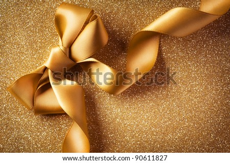 Holiday Background.Greeting Card.Gold Bow on a Blinking Background - stock photo