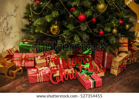 holiday background. Presents, gift box, under the Christmas tree with colorful toys vintage style old