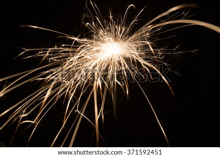holiday background with a sparkler, close up - stock photo