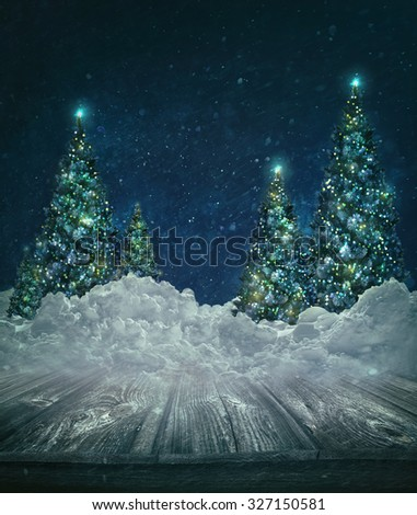 Holiday background with Christmas lit trees in snow