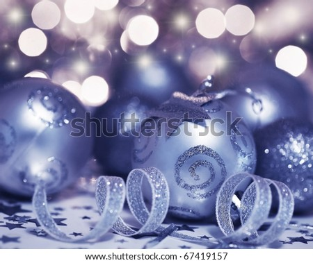 Holiday background with Christmas tree bauble ornament and star decoration over abstract defocus lights - stock photo