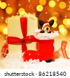 Holiday background with cute Santa boot Christmas tree decorative ornament & gift box in snow over abstract defocus lights - stock photo