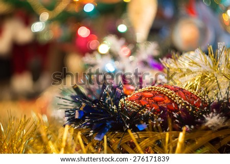 Holiday background with decorations on Christmas tree. - stock photo