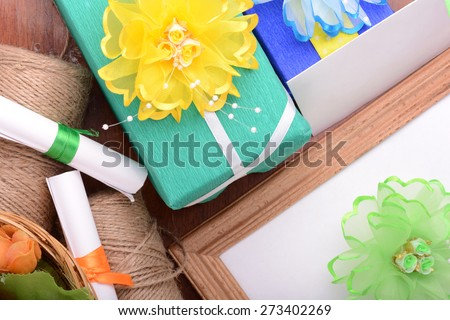holiday background with flowers, gift boxes, ribbons and decoration