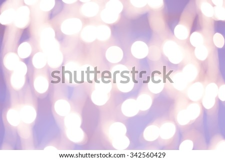 Holiday background with white blurred defocused bokeh. Christmas background. Horizontal. Lilac tone - stock photo
