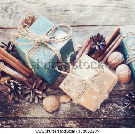 Holiday Blue, Beige Boxes with Linen Cord, Cinnamon, Pine cones, Walnuts. Toned image - stock photo