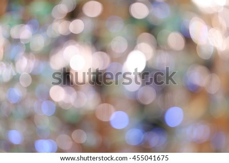 Holiday blurred bokeh background. Christmas background. Horizontal. Cold beige tone with pink, purple, green and orange - stock photo