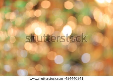 Holiday blurred bokeh background. Christmas background. Horizontal. Warm green and orange tone - stock photo