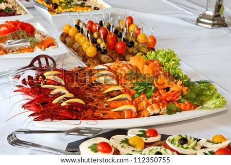 Holiday buffet food on the table. - stock photo