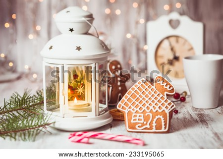 Holiday candies - Santa stuffs in white bootie, Christmas decor - stock photo