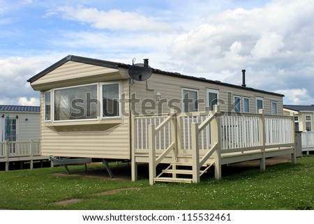 Holiday caravan or mobile home on trailer park. - stock photo