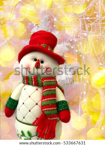Holiday Christmas decorations, snowman on the yellow background with big bokeh