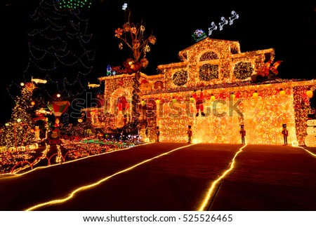 Holiday, Christmas House Covered in Lights and Decorations
