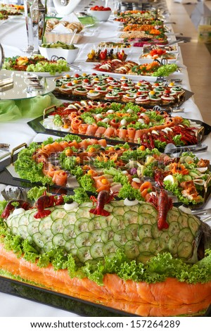 Holiday cold buffet food on the table. - stock photo