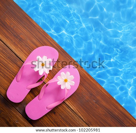 Holiday concept, flip flops a the pool - stock photo