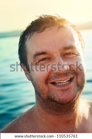 Holiday concept. Happy Man is enjoying on holidays at the sea - stock photo