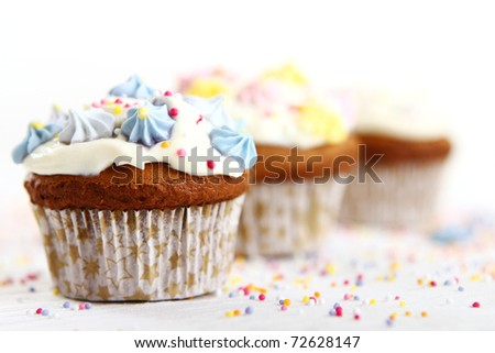 Holiday cupcakes decorated with colorful flowers - stock photo