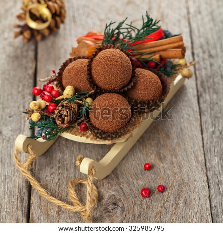 Holiday Decorations. Christmas background with Chocolate Cocoa Honey Balls. Selective focus.