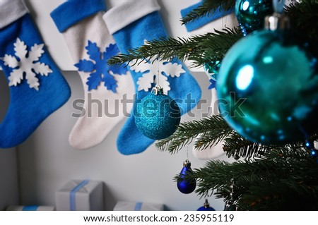 Holiday decorations on the Christmas tree and socks for gifts - stock photo