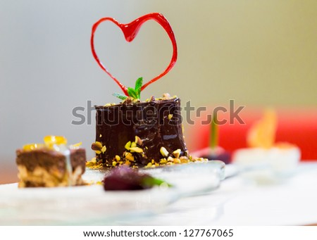 holiday dessert with caramel heart of Saint Valentine's Day in the restaurant - stock photo
