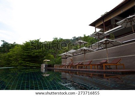 Holiday destinations -  poolside with deck chairs. - stock photo