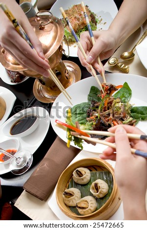 Holiday dinner in chineese restaurant - stock photo